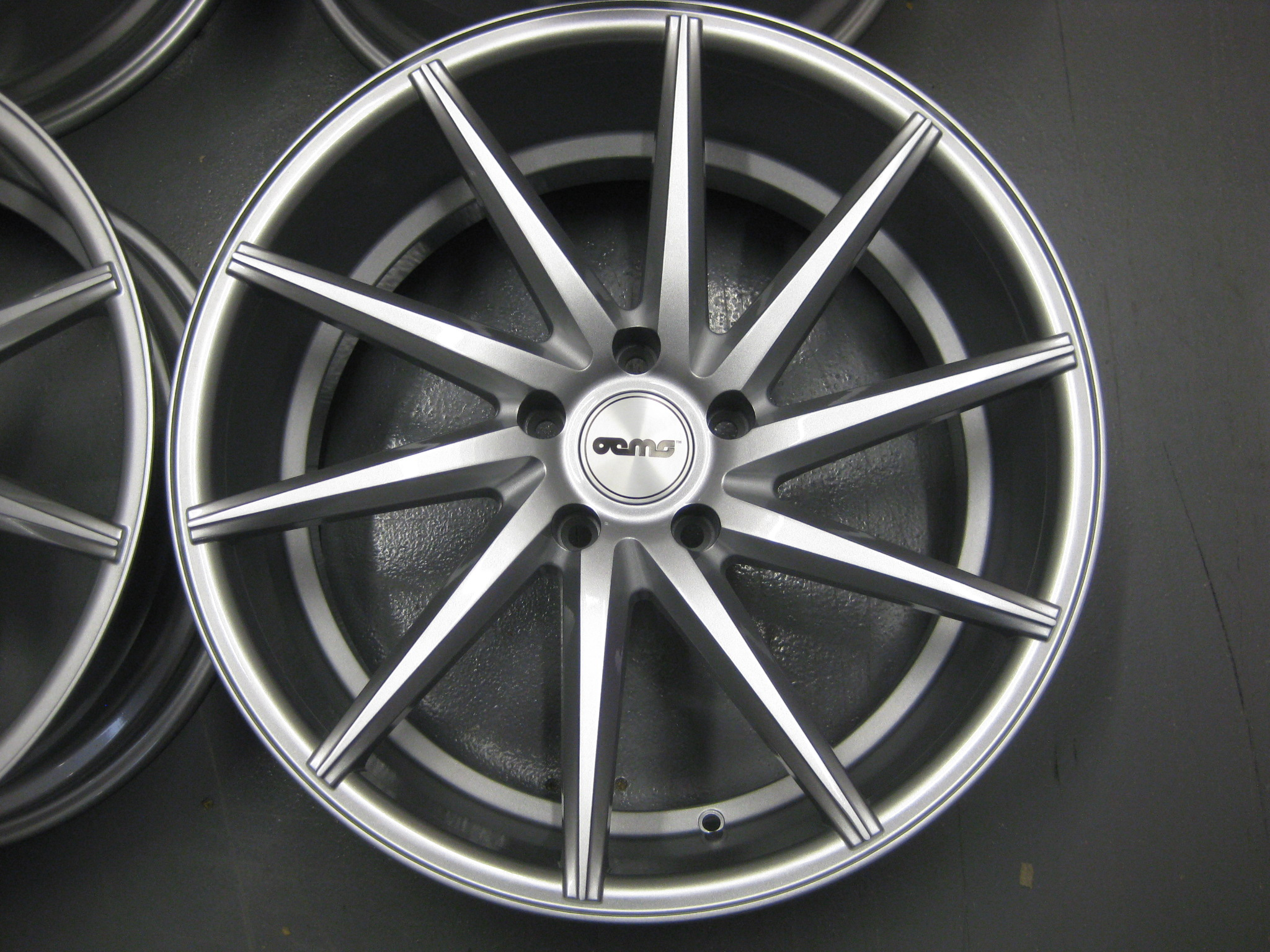 "NEW 20"" OEMS CVT DIRECTIONAL ALLOYS IN SILVER, WIDER 10.5"" REAR"